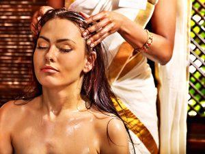 Young woman having head ayurveda spa treatment.