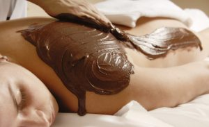 cacao therapy applied to young woman in a spa