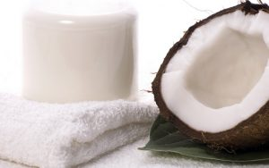 coco bath items. coconut, milk, towel. white spa